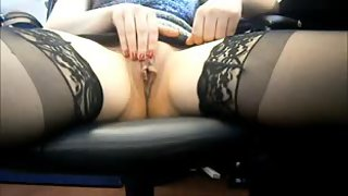 Redhead mature masturbating in the office at home