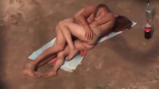 Orgy on a public naturist beach filmed by spycam