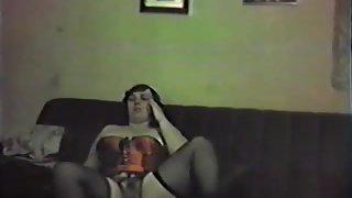 My slut wife in her crimson basque and black stockings showcase off her honeypot