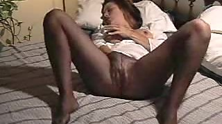 Wife in stocking kneading her mature pussy in bed
