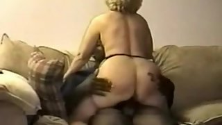 Hairy pussy mature blonde dame riding on top of a black mans schlong while i film