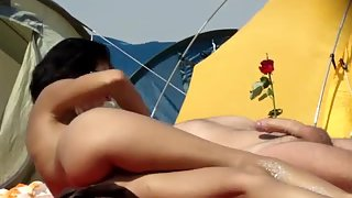 I filmed a doll touching her husband on a nudist beach rubbing willy