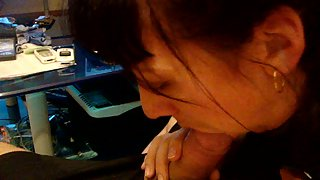 Brunette giving a very sultry pov blowjob to her hubby on the couch