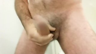 Hotel bathroom jack-off and cumshot