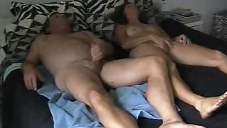 Wife and husband masturbating together in bed